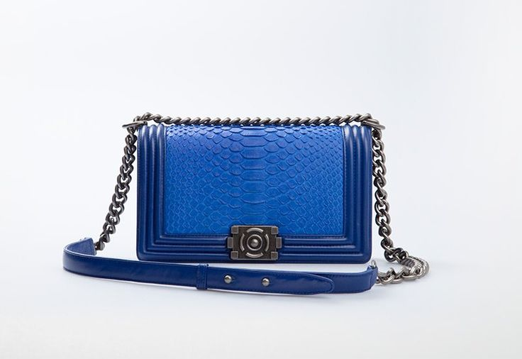 Elevancy Blue by Cupio.A pretty hand bag crafted from genuine phytons leather in bluecolor. Features with sling strap in chain and button from iron.  http://www.zocko.com/z/JJunG