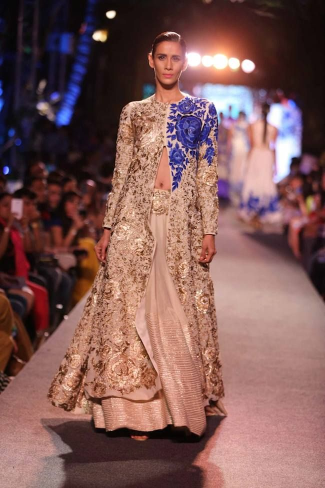 Manish Malhotra continued Lakme Fashion week with his new Summer/Resort collection entitled Blue Runway by Manish Malhotra. Featuring mostly two piece outfits Malhotra focused on pairing intricate tops with pants and lengha. Using bright floral patterns with lightweight material the flowing gowns are perfect for summertime shenanigans