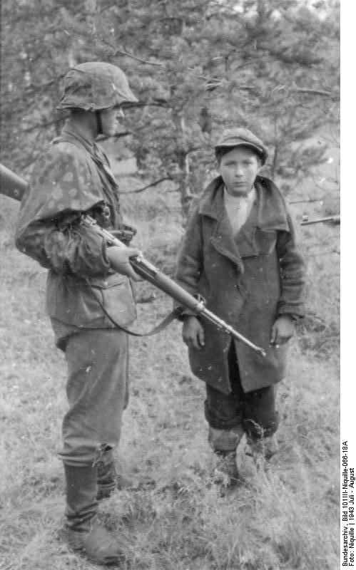Soviet partisan caught by SS, Soviet Union July - August 1943.