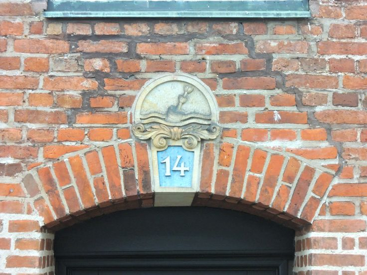 Kay Bojesen had his logo 'The Bouy' casted above the door at his first workshop in Nybrogade 14 back in 1913. The Buoy is still imprented in the bricks above the door of Nybrogade.