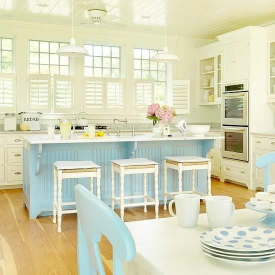 Kitchen with cream walls and cabinets and light blue for Cottage kitchen island ideas