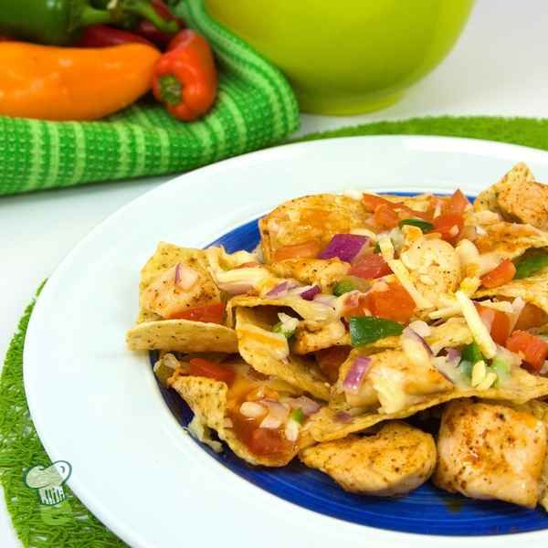 Chicken Nachos: These delicious nachos are loaded with cheese, but not dripping in grease. This nachos recipe has half the calories of restaurant nachos. Get all the flavor without all the extra fat.