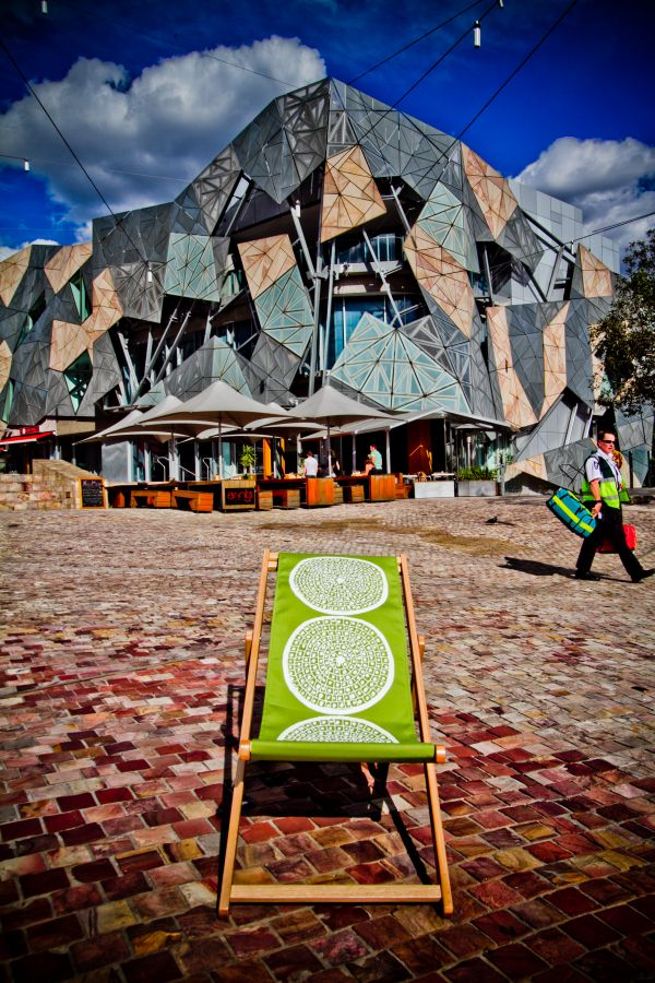 Federation Square, Melbourne CBD - perfect place to sit in the sun, listen to music from the big screen or have a look at the street artists...
