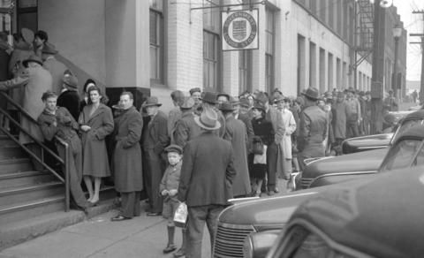 """People lined up in front of the Government Liquor Store on Beatty Street, 1943. (Photo by Jack Lindsay for the """"Vancouver News-Herald,"""" via Vancouver Archives)"""