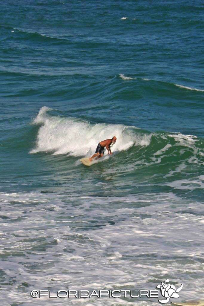 Surfers At The Juno Beach Pier Juno Beach Juno Beach Pier And Surfers