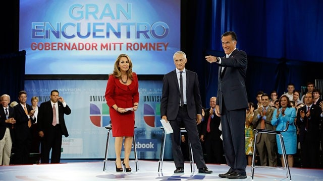 """#24 9/19/12- Republican presidential candidate Mitt Romney participates in a Univision """"Meet the Candidates"""" forum with Jorge Ramos and Maria Elena Salinas in Coral Gables, Fla., Wednesday, Sept. 19, 2012. (Charles Dharapak/AP Photo)"""