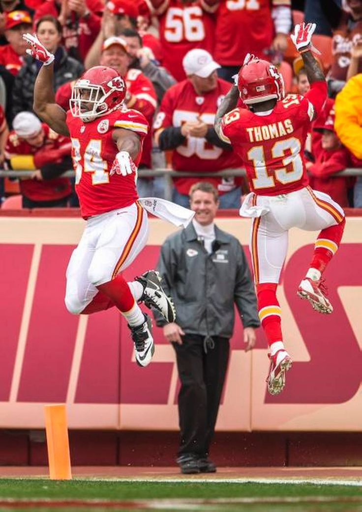 Kansas City Chiefs running back Knile Davis (34) and Kansas City Chiefs running back De'Anthony Thomas (13) leaped in the air together in celebration of Davis' 70-yard touchdown in the third quarter against the Oakland Raiders during NFL action on December 14, 2014 at Arrowhead Stadium in Kansas City, Mo. The Chiefs won 31-13.