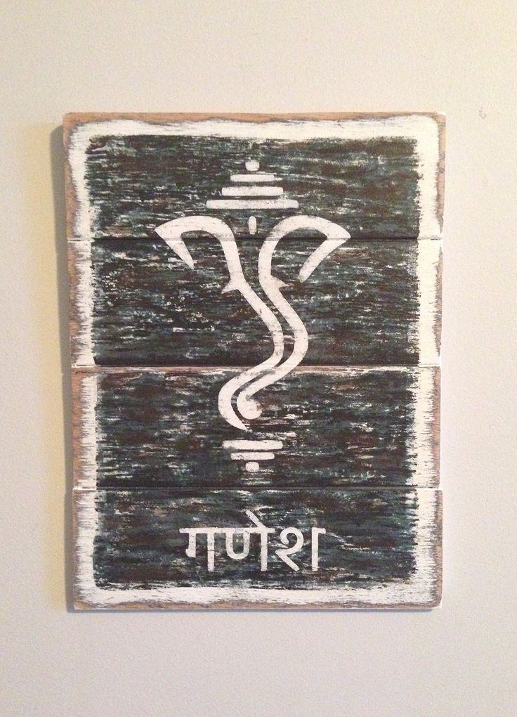 "Distressed, Handmade Ganesh/Ganesha Wood Painting with Sanskrit Name- Fits Reclaimed Wood, Pallet, Industrial and Asian/Indian Decor. Measures 9 by 12. Remover of Obstacles, Provider of Prosperity. Who doesn't need a Ganesh watching over them? This important ancient Hindu deity is popular in many parts of the world and this piece would make a great housewarming gift. The 9"" by 12"" painting features an off-white depiction of Ganesh on a black, teal, white and brown layered and heavily..."