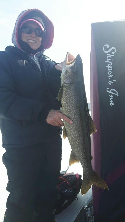 Ice fishing is not over standing on 12 inches of ice and the lake trout are…