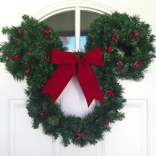 Just added a little Disney holiday magic to our front door.