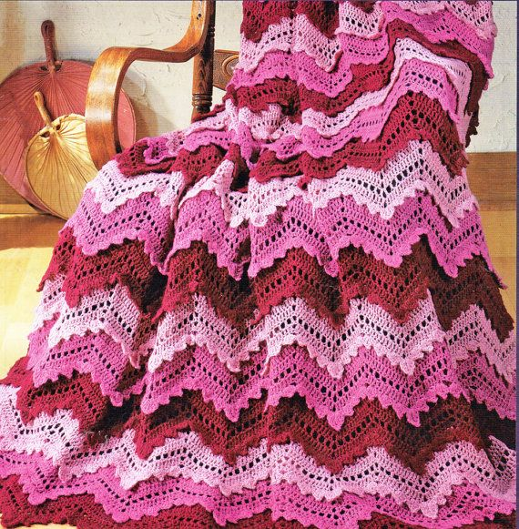 This is a crochet afghan pattern adds interest to the traditional ripple or zigzag afghan design with rows of shell stitches as well as large