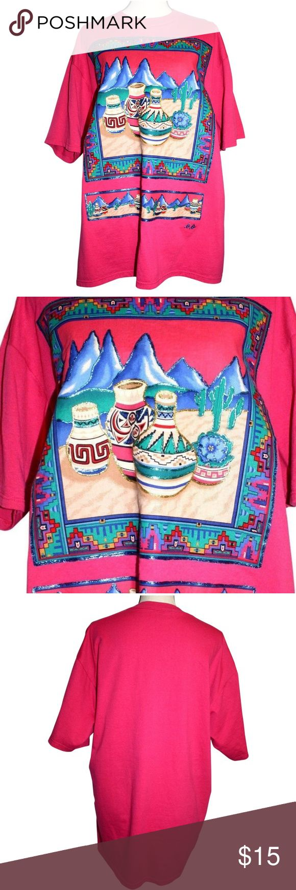 Sunbelt Sportswear Womens XL Top Pink Glitter S/S Sunbelt Sportswear Womens XL Top Pink Embellished Southwestern Glitter Paint.  Short sleeved t-shirt in a blend of 50% cotton and 50% polyester.   Southwestern print with glittery blue, green and gold paint embellishments.   Flat lay measurements are:  Chest:     23 inches Length:   30 1/2 inches Sunbelt Tops Blouses