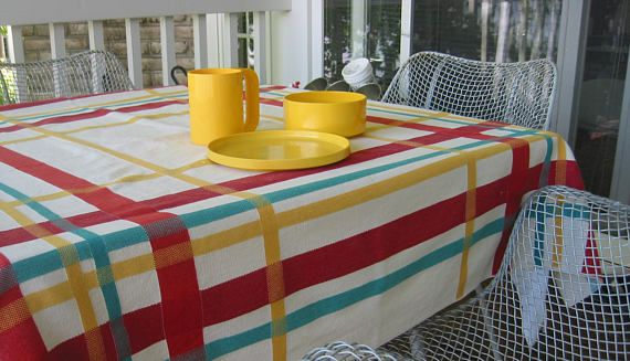 Vintage 1950s Classic Plaid Tablecloth.  Great colors -- bright and retro with red, yellow and turquoise.  Fabric: Woven cotton, medium to heavy weight  Size: Square, 46 x 46 inches  Condition: Very good condition. There are a couple of weave snaps and one tiny discoloration stain. No smells.  Questions? Please ask. Thanks for looking.  (Note: Sale is for one tablecloth, not accessories.)