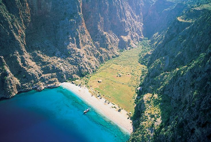 Butterfly Valley, Turkey You can reach the Butterfly Valley by boat from Oludeniz. It is protected and forbidden to build since 1995. The rare Tiger Butterflies survive in this valley. Offers tents and bungalows for accomodation.Towards inland of the Valley there are waterfalls. Butterfly Valley is one of the best diving areas in the world.