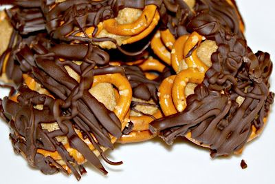 1 cup creamy peanut butter   2 tablespoons softened butter   1/2 cup powdered sugar   3/4 cup brown sugar   Pretzels   1 bag semi-sweet chocolate chips    - mix pd and butter  - Add sugars beat  - Roll into balls if needed add more pwd sugar  - Sandwich between pretzels and place in freeze for 30 mins  - Heat chocolate in metal bowl over simmering water  - Dip pretzel in chocolate and place on wax papered cookie sheet