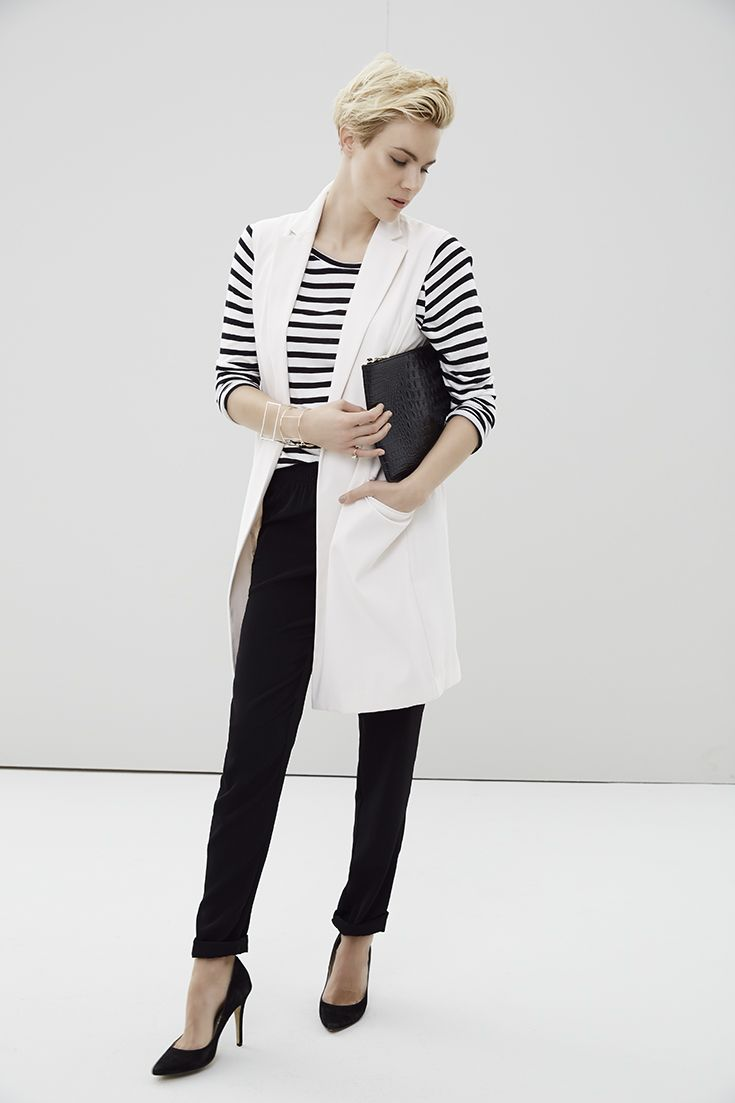 The timeless classic updated. The striped top paired with a cream sleeveless blazer and black pants. #miladys #stripes #stripetop #sleevelessblazer