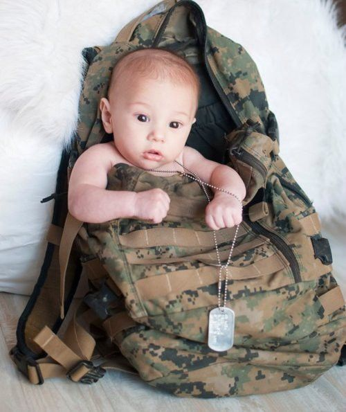 awwww. In daddy's bag! Why didn't I think of this? Idk where Tyler's extra dog tag is. Maybe his hat instead? And her in pink