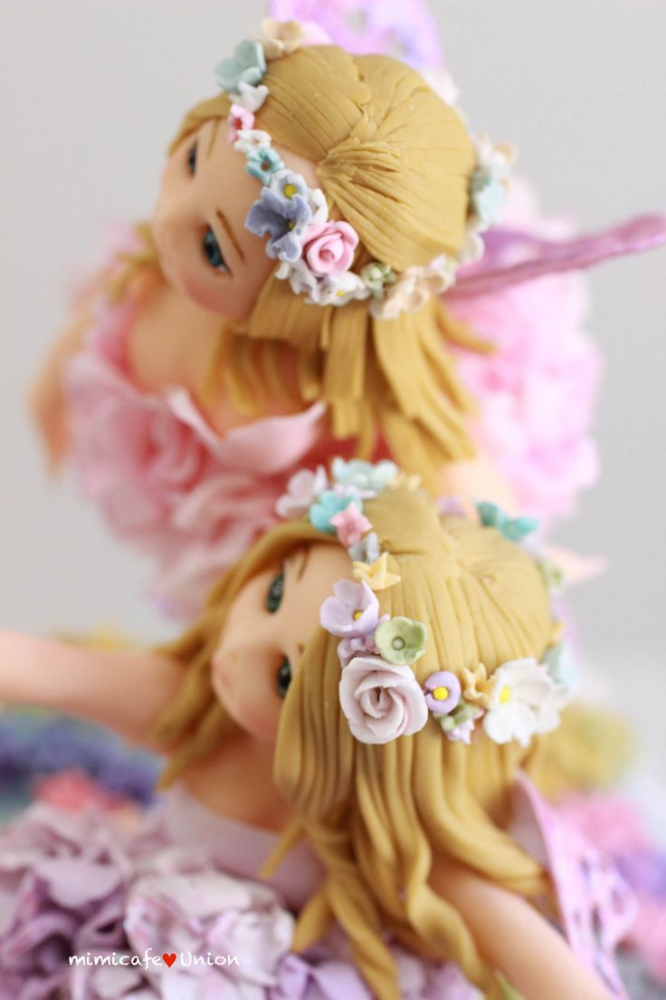 """FANTASY FLOWER """"FAIRY TWINS DELIVERING SPRINGTIME"""" ONLY USED A COUPLE OF CUTTERS (DAISY CUTTER & CARNATION CUTTER), OTHERWISE EVERYTHING ELSE IS MADE FROM HAND. (NO MOLDS WERE USED). ALL MADE FROM FONDANT AND SOME GUM PASTE FOR FLWERS (NO TYLOSE WAS USED)."""