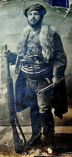 Portrait of a volonteer member of the Turkish National Forces, from Kütahya (province), during the Turkish War of Independence (ca. 1920).