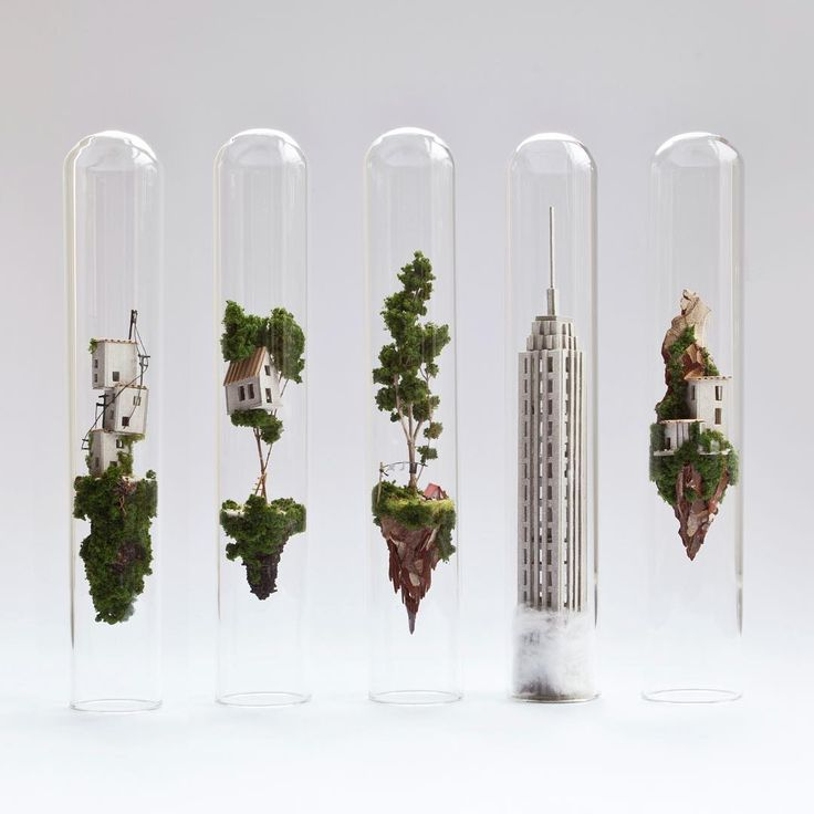 Dutch artist Rosa de Jong creates tiny floating islands inside test tubes.