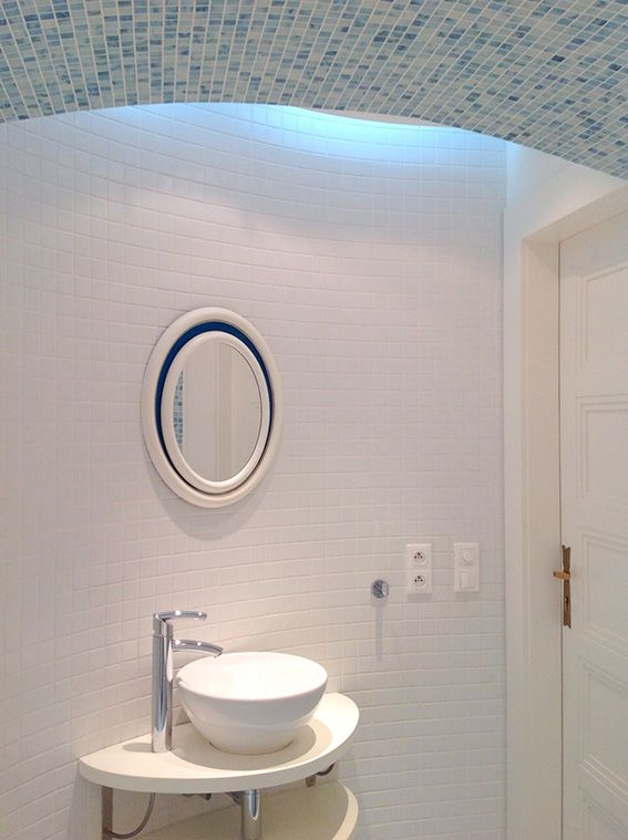 bathroom with curved wall and arched ceiling