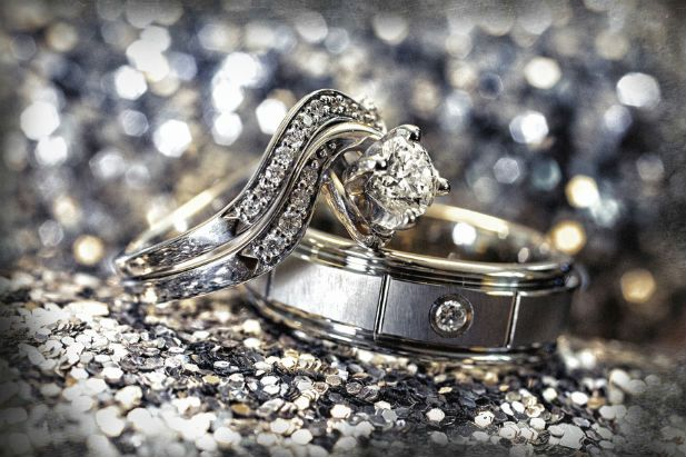 Unique engagement ring and wedding bands (Photo by Jeff Kolodny Photography)