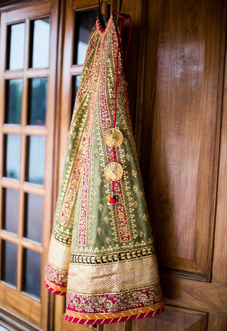 Olive green, gold and a flash of pink with gota patti- beautiful lehenga
