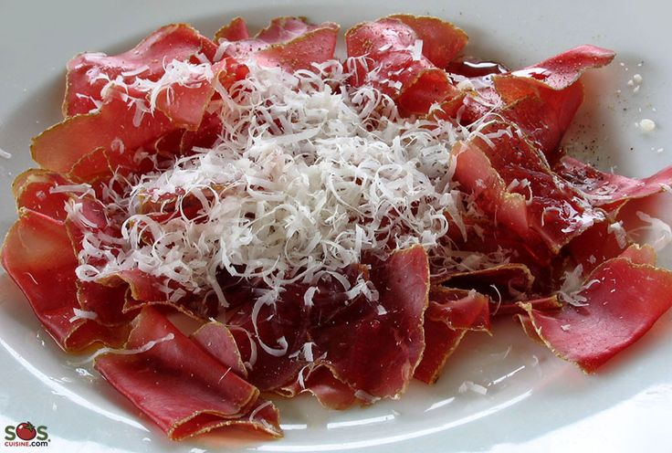 """SOSCuisine: """"Bresaola"""" al Carpaccio Originating in the alpine valley of Valtellina, not far from Milan, «bresaola» is a #beef fillet which is first cured in salt and spices, and then hung to dry for at least 1 months. The microclimate of the Alps offers ideal conditions for its ageing process. A close (but dryer) relative is the Swiss «Viande des Grisons» or «Bündnerfleisch»."""