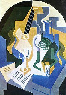 Juan Gris, Nature morte au plat de fruits et à la mandoline, 1919, 92 × 65 cm), Fondation Beyeler, Bâle.