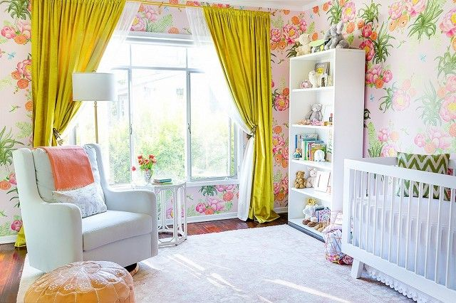 Feminine nursery with custom floral wallpaper, bright yellow curtains and a pale blue armchair