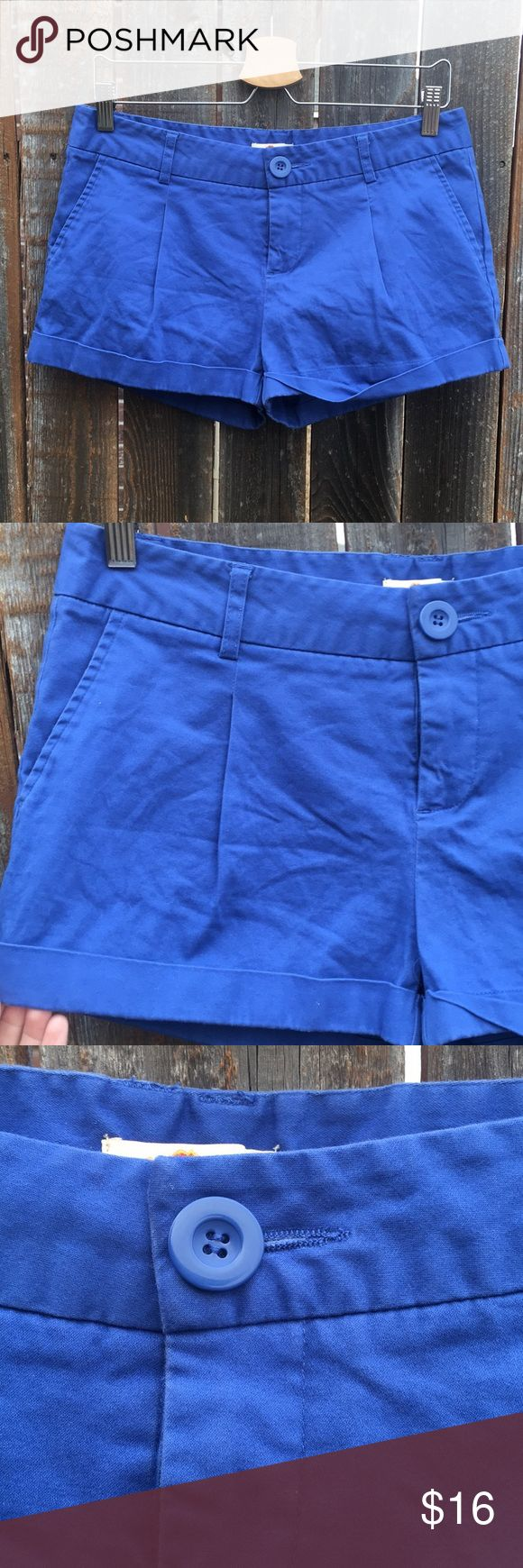 • [forever 21] blue chino like shorts • Super cute blue shorts from Forever 21. Size large. They are khaki like or chino like in material. Very thick and soft! Cuffed hem.. a little pleating on the front. Functioning pockets in the front and the back.   ❌NO TRADES ❌NO OFF APP PAYMENT 🚭SMOKE FREE HOME 🐶🐶 TWO PUPS Forever 21 Shorts