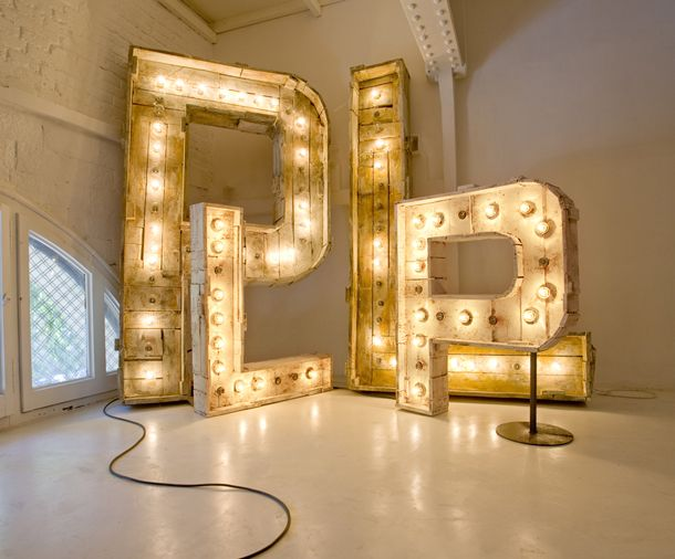 Oversized lit letters in gold wow how fun would those for Living room 6 letters