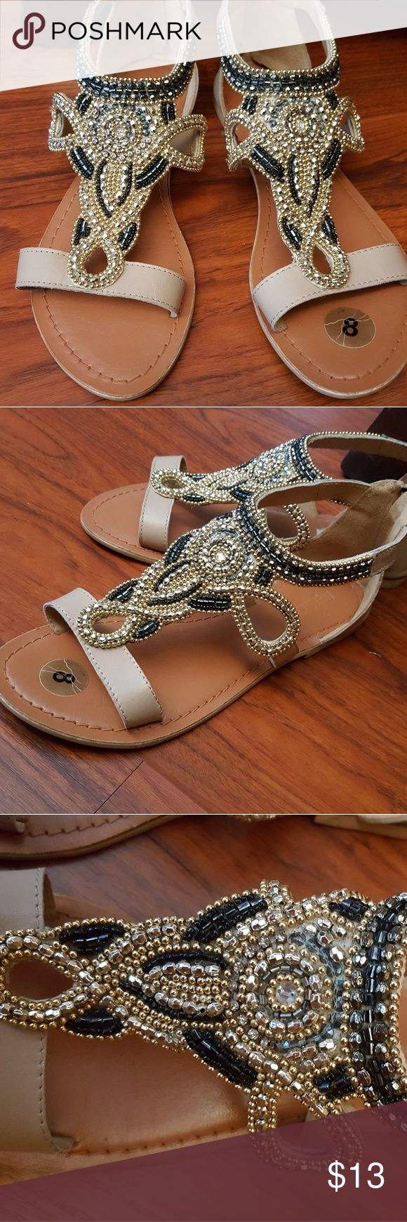 Morrocan Jeweled Taupe Sandals Very good condition. Gorgeous jewels that will ascade the top of your feet. Taupe in color, with gold, silver & black embellishments. Shoes Sandals