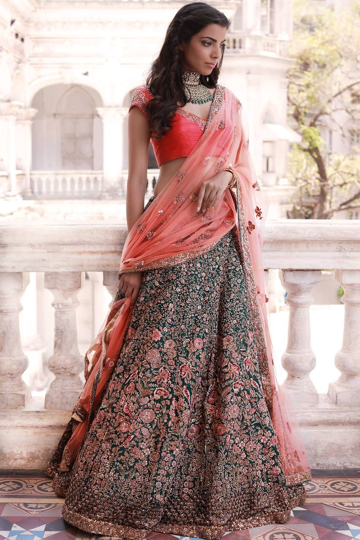 The ethereal verdant green lehenga is abloom with flowers and chirping birds in beautiful hand-embroidery. An embellished coral blouse and dupatta complete the finely handcrafted ensemble. 19 November 2017