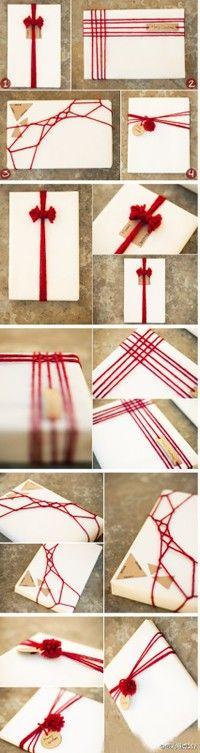 Flor DIY del tutorial para envolver regalos usando lanas o hilos