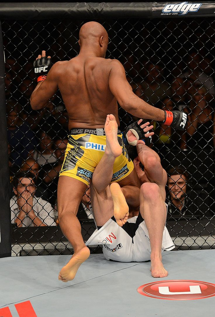 Anderson Silva hits Chael Sonnen with a knee during their UFC middleweight championship bout at UFC 148 inside MGM Grand Garden Arena on July 7, 2012 in Las Vegas, Nevada.