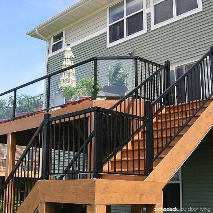 Elevated Deck Railing Ideas |  Metal rails, slender staircase pickets and glass panel inserts on the upper deck, maximize safety, style and a backyard view.