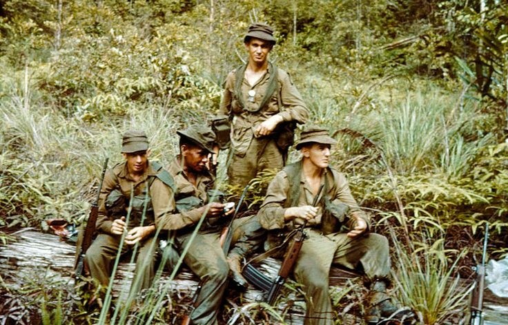 Infantrymen from the 3rd Battalion, the Royal Australian Regiment (3 RAR) in Borneo in May 1965. They are on patrol near the border between the North Borneo state of Sarawak and the Indonesian-controlled area of Kalimantan. The Section Commander, Corporal Mial Bingarape, is taking a compass reading. Australian soldiers in Borneo found that the tactic of using small four-man patrols worked well in the rugged and densely wooded terrain.