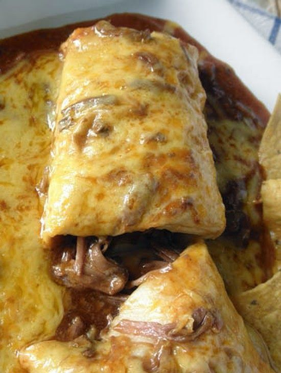 Chile Colorado Burritos ~ Tender chunks of beef in a yummy sauce, wrapped in a soft flour tortilla, smothered in more sauce and cheddar cheese, and then broiled to bubbly perfection. Mmmmmm..