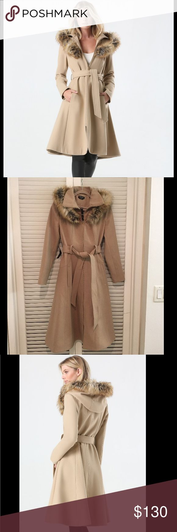 """Bebe maxi coat ❄️❄️❄️ NWT-Impeccable tan wool-blend coat in a right-now midi length with exceptionally flawless tailoring and topstitching, sleek welt pockets and a deep stand collar with faux fur-trimmed hood. Shaping seams, flared hem and detachable tie belt keep the look flattering. Front goldtone zip closure. Fully lined. 60% Wool, 26% polyester, 11% viscose, 2% acrylic, 1% nylon Dry clean Center back to hem: 44"""" (112 cm) bebe Jackets & Coats"""