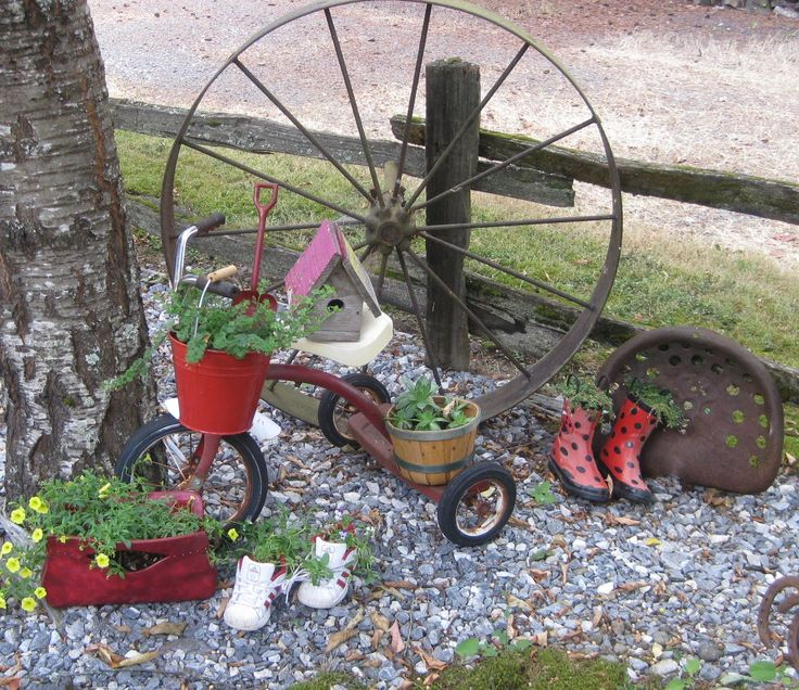 Country Junk....  Wagon wheel, seat and trike.  Garden Ideas. Unique planters. As you can see I plant in everything, old purse, tennis shoes, boots, buckets and baskets.