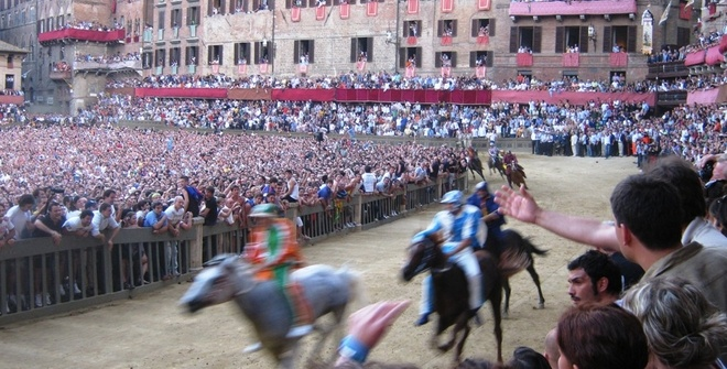 The emotional Palio race in Siena.  www.tuscantoursandweddings.com