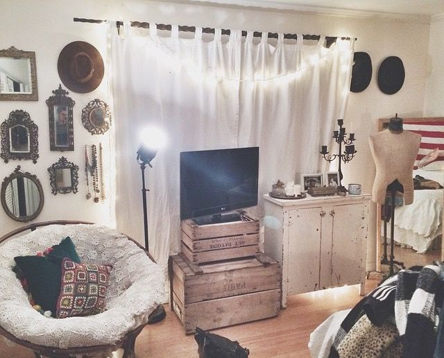 Love this mix of antiques & rustic with crates, wall grouping of old mirrors & hats, old dress form, etc.