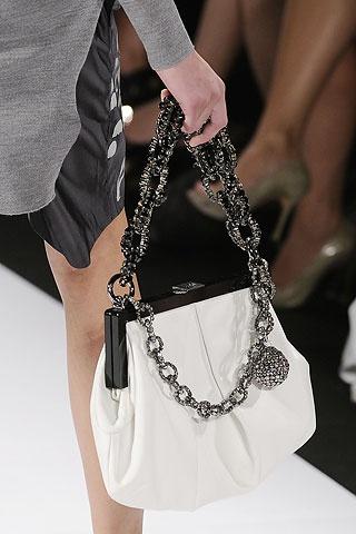 Vera Wang bag.....I have this in purple . de94a0a3cc690