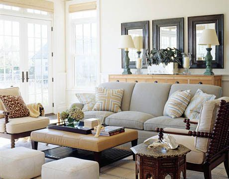 Coastal Chic: Family Room, nice neutral color scheme, love the mirrors and idea of lamps behind sofa.  Instead of big dresser, a simple shelf with lamps would be a space saver and give the same look