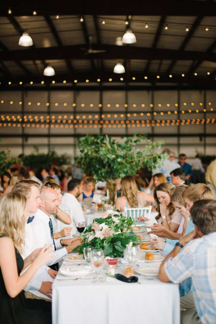 Photography: Blue Rose Photography - bluerosepictures.com   Read More on SMP: http://www.stylemepretty.com/2016/10/24/romantic-airport-hanger-wedding/