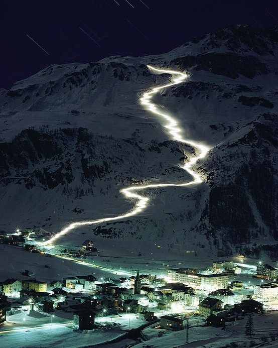 Unique photo of skiers descending with torches down from the glaciers of Mont Blanc to the town of Val d'Isere in France. Looks unique, right?