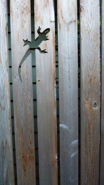 Lizard cut-out on the fence...Portland Oregon Garden Tour, fence details, fencing, landscape architecture. Garden fence ideas