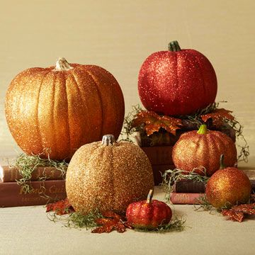 Glittery Pumpkins  Add some glam to your indoor pumpkin decor with a bit of glue and glitter in this fun Halloween crafts project you can make in minutes. To make this shimmering faux pumpkin arrangement, use a paintbrush to coat strips of each pumpkin with clear-drying white crafts glue. Add glitter to the pumpkin, working in small sections so the layer of glue doesn't dry out.