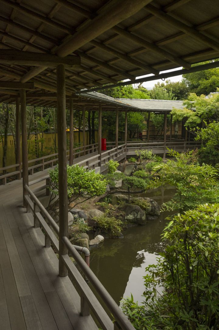 A walkway around the pond in Taishakuten shibamata garden, Japan; maybe a walkway surrounding the city's central garden
